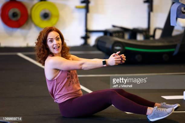 Lyndsey Roberts, Strong Like a Mutha company founder, teaches gym members during a fitness class on August 31, 2020 in Glasgow, Scotland. Indoor gyms...