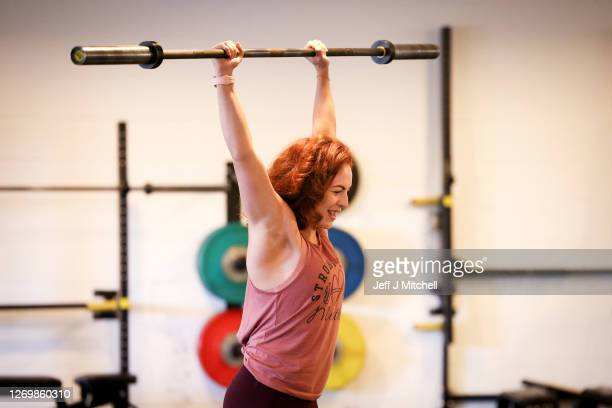 Lyndsey Roberts, Strong Like a Mutha company founder teaches gym members during a fitness class on August 31, 2020 in Glasgow, Scotland. Indoor gyms...