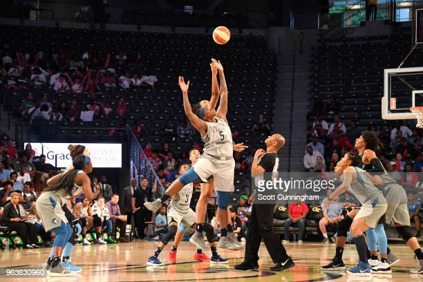 Lynetta Kizer of the Minnesota Lynx and Imani McGeeStafford of the Atlanta Dream reach for control of the ball on May 29 2018 at McCamish Pavilion in...