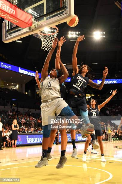 Lynetta Kizer of the Minnesota Lynx goes to the basket against Jessica Breland of the Atlanta Dreamon May 29 2018 at McCamish Pavilion in Atlanta...