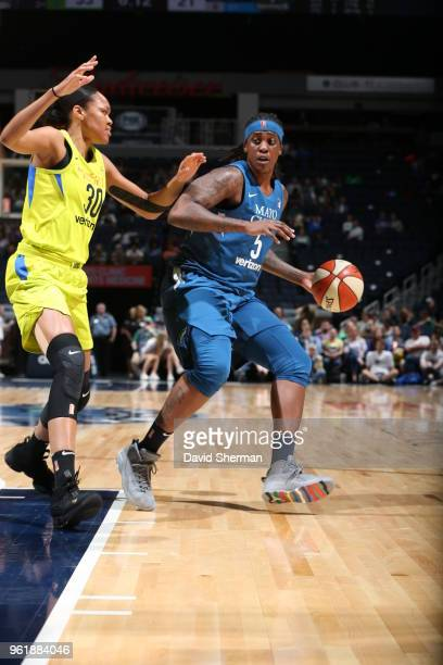 Lynetta Kizer of the Minnesota Lynx handles the ball against Azura Stevens of the Dallas Wings on May 23 2018 at Target Center in Minneapolis...