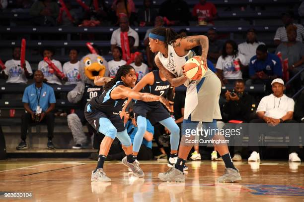 Lynetta Kizer of the Minnesota Lynx handles the ball against Jessica Breland of the Atlanta Dream on May 29 2018 at McCamish Pavilion in Atlanta...