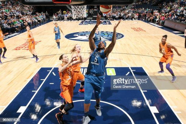 Lynetta Kizer of the Minnesota Lynx rebounds the ball against the Phoenix Mercury on June 1 2018 at Target Center in Minneapolis Minnesota NOTE TO...
