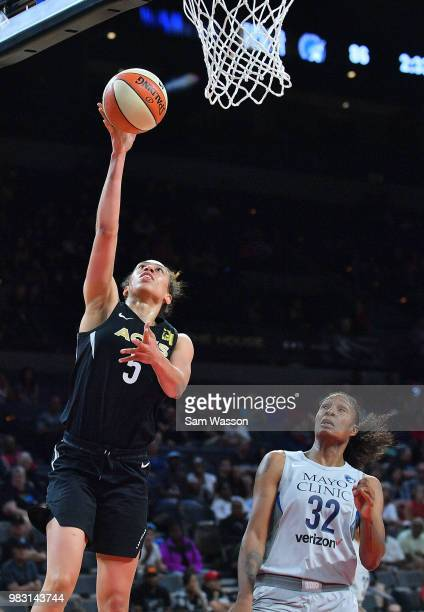 Lynetta Kizer of the Minnesota Lynx scores on a layup against Rebekkah Brunson of the Minnesota Lynx during their game at the Mandalay Bay Events...