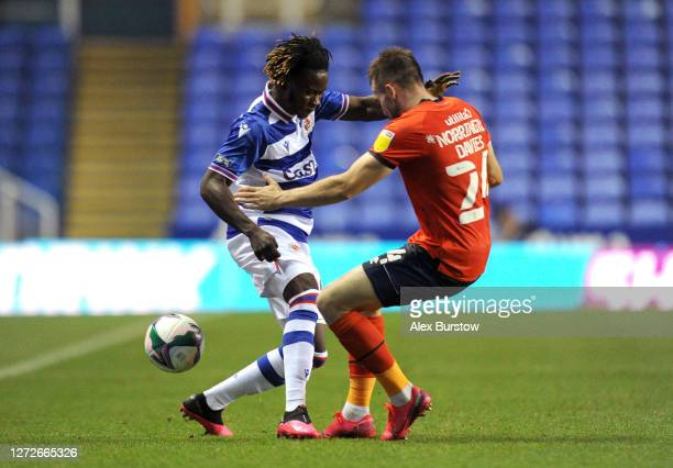 Lynford Sackey of Reading FC battles for possession with Rhys NorringtonDavies of Luton Town during Carabao Cup Second Round match between Reading FC...