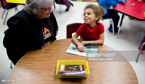 Lynn Adams helps Ja'Syiah Doyle with her reading during the start of Adams' kindergarten class at Longley Elementary School Adams has been teaching...