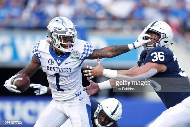 Lynn Bowden Jr. #1 of the Kentucky Wildcats runs for a first down after catching a pass against Jan Johnson of the Penn State Nittany Lions in the...