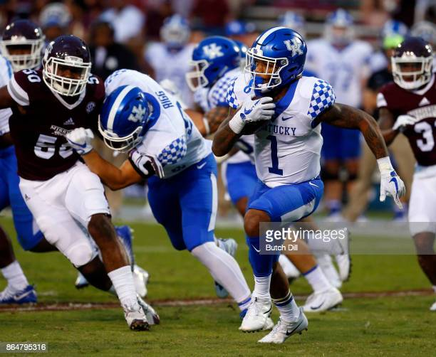 Lynn Bowden Jr #1 of the Kentucky Wildcats tries to find a hole as he carries the ball during the second half of an NCAA football game against the...