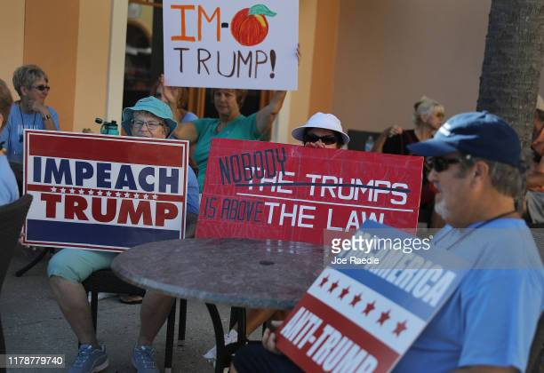 Lynn Cook and Mary Ferguson join with others to protest against President Donald Trump before his scheduled event at the Sharon L Morse Performing...