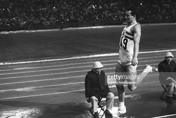 Lynn Davies of Great Britain completing his gold medal winning long jump of 807 metres at the 1964 Tokyo Olympics