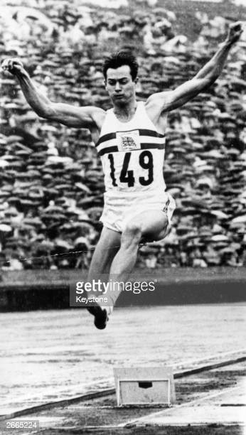 Lynn Davies of Great Britain making his gold medal long jump of 26ft 5 and a half inches in the pouring rain of the Tokyo Olympics.