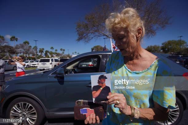 Lynn Eisenhower of Jupiter FL a former resident of Massachusetts and a lifelong New England Patriots fan holds a photo of quarterback Tom Brady as...
