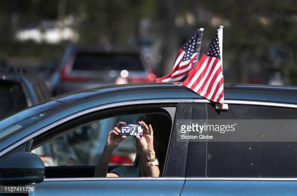 Lynn Eisenhower of Jupiter FL a former resident of Massachusetts and a lifelong New England Patriots fan takes a photo from her car as she cruises...
