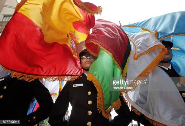 Lynn English ROTC cadet Alicia Donoso center stands at rest after after presenting the country flags during the Opening Ceremony of Sail Boston at...