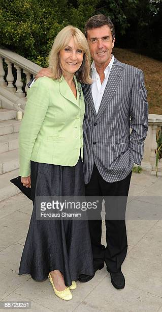 Lynn Faulds Wood and John Stapleton attend Pratham UK's Indian Summer Garden Party at The Chelsea Conservatory on June 28 2009 in London England