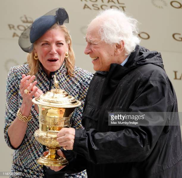 Lynn Forester de Rothschild and Sir Evelyn de Rothschild hold the trophy after winning The Prince of Wales Stakes on day two of Royal Ascot at Ascot...