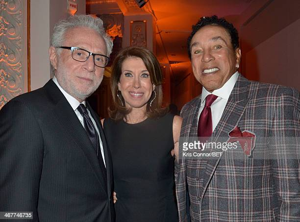 Lynn Greenfield Wolf Blitzer and Smokey Robinson attend the Debra Lee PreDinner the National Museum of Women in the Arts on February 7 2014 in...