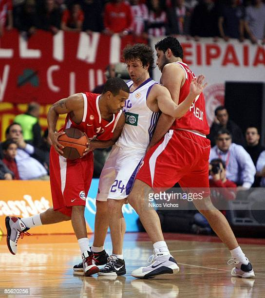Lynn Greer #11 of Olympiacos competes with Raul Lopez #24 of Real Madrid during the Play off Game 2 Olympiacos Piraeus v Real Madrid on March 26 2009...