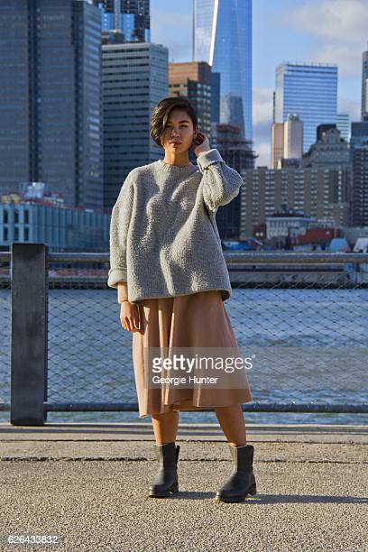 Lynn Kim Do seen wearing oversized large knit grey ribbed sweater by Mini Market, sheer peach onesie with high neck by Topshop, peach midi loose...
