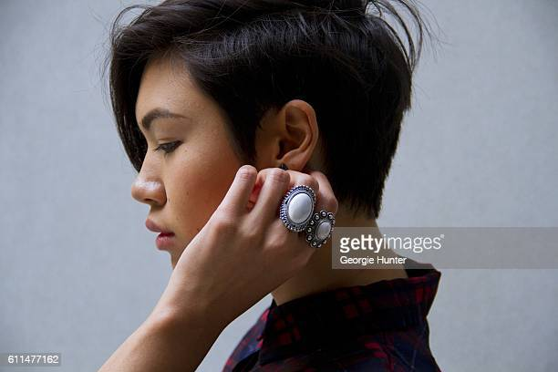 Lynn Kim Do wearing red and blue vintage sheer plaid tartan dress gunmetal silver stud earrings and vintage oversized silver and white opal rings on...