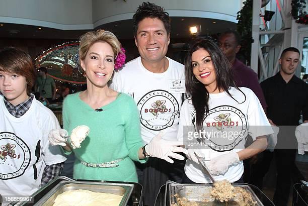 Lynn Martinez Louis Aguirre and Adriana De Maura participate in 5th Annual Thanksgiving Feed A Friend at Bongos on November 22 2012 in Miami Florida