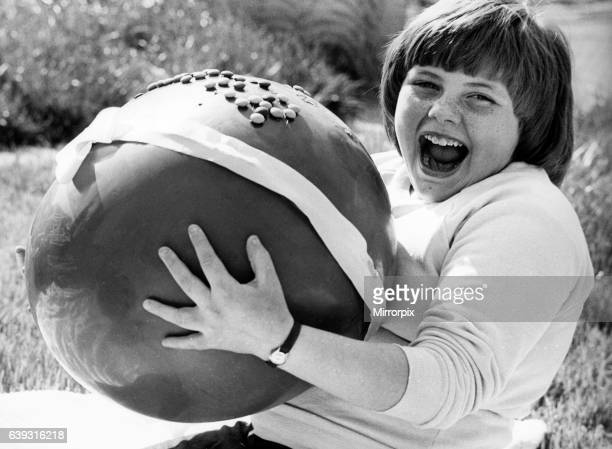 Lynn McGiven pictured with her enormous prize a large chocolate easter egg after winning an Easter Card Colouring Competition 18th April 1981