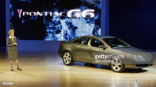 Lynn Myers, General Manager Pontiac-GMC, shows off the new 2005 Pontiac G6 during the press days 05 January 04 at the North American International...