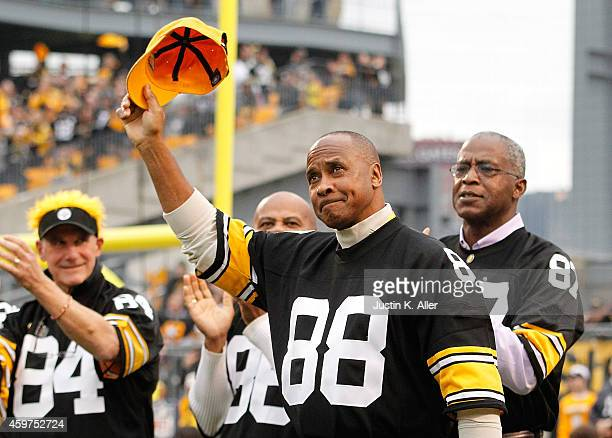Lynn Swann a member of the 1974 Super Bowl team is honored during a halftime ceremony during the game between the New Orleans Saints and the...