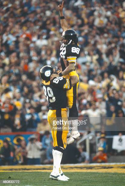 Lynn Swann and Bennie Cunningham of the Pittsburgh Steelers celebrates after Swann scored a touchdown against the Los Angeles Rams during Super Bowl...