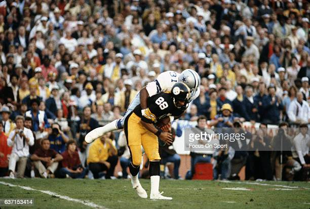 Lynn Swann of the Pittsburgh Steelers catches a pass and gets tackled by Benny Barnes of the Dallas Cowboys during Super Bowl XIII on January 21 1979...
