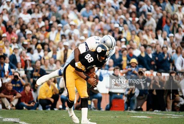Lynn Swann of the Pittsburgh Steelers gets tackled by Benny Barnes of the Dallas Cowboys during Super Bowl XIII on January 21 1979 at the Orange Bowl...