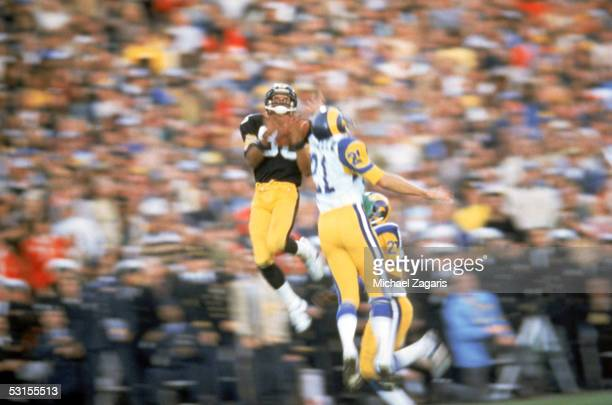 Lynn Swann of the Pittsburgh Steelers makes a catch against the Los Angeles Rams during Super Bowl XIV at the Rose Bowl on January 20 1980 in...