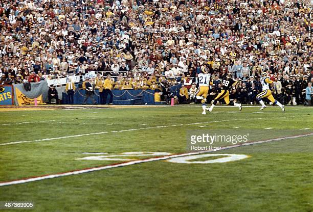 Lynn Swann of the Pittsburgh Steelers runs to make the catch over Nolan Cromwell and Pat Thomas of the Los Angeles Rams during Super Bowl XIV on...