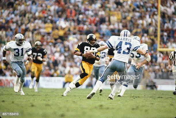 Lynn Swann of the Pittsburgh Steelers runs with the ball after catching a pass against the Dallas Cowboys during Super Bowl XIII on January 21 1979...