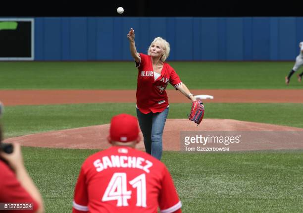 Lynn the mother of Aaron Sanchez of the Toronto Blue Jays throws out the first pitch to her son before the start of MLB game action against the...