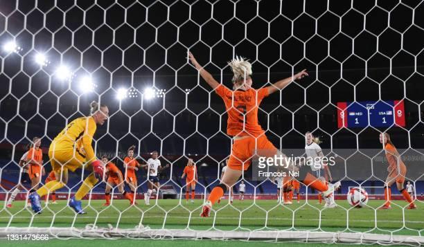 Lynn Williams of Team United States scores their side's second goal past Sari van Veenendaal and Stefanie van der Gragt of Team Netherlands during...
