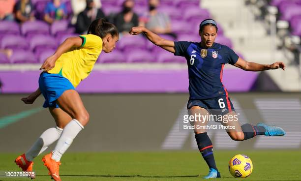 Lynn Williams of the United States attempts a shot past Rafaelle during a game between Brazil and USWNT at Exploria Stadium on February 21, 2021 in...