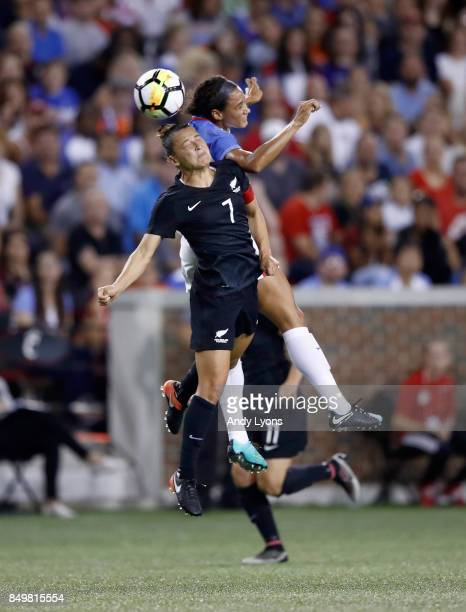 Lynn Williams of the USA and Ali Riley of New Zealand battle for the ball during the match at Nippert Stadium on September 19 2017 in Cincinnati Ohio...