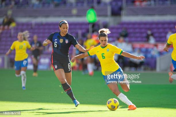 Lynn Williams of the USWNT and Tamires battle for the ball during a game between Brazil and USWNT at Exploria Stadium on February 21, 2021 in Orlando...