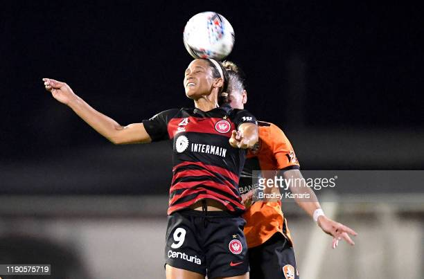 Lynn Williams of the Wanderers and Celeste Boureille of the Roar challenge for the ball during the round three W-League match between the Brisbane...