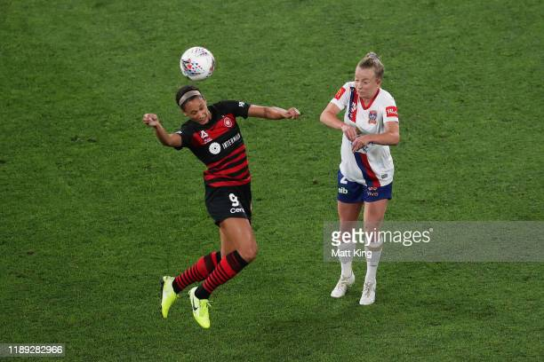 Lynn Williams of the Wanderers heads the ball under pressure from Hannah Brewer of the Jets during the round 2 W-League match between the Western...