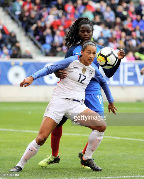 Lynn Williams of United States of America and Griedge Mbock Bathy of France fight for the ball during the SheBelieves Cup at Red Bull Arena on March...