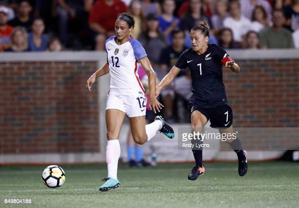 Lynn Williams#12 of the USA advances the ball down the field while defended by Ali Riley of New Zealand at Nippert Stadium on September 19 2017 in...