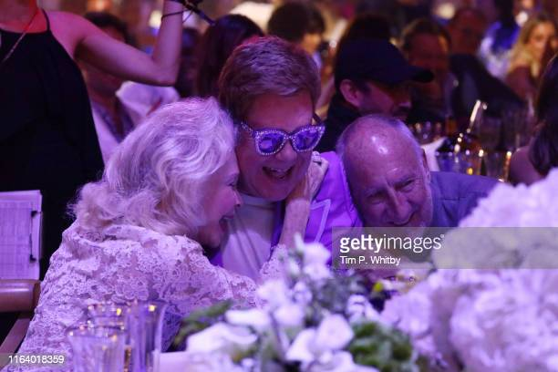 "Lynn Wyatt Elton John and Pete Townshend attend the first ""Midsummer Party"" hosted by Elton John and David Furnish to raise funds for the Elton John..."