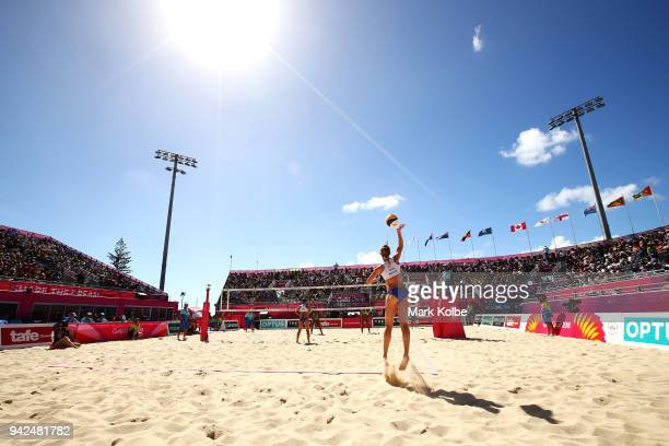 Lynne Beatie of Scotland serves during the Beach Volleyball Women Preliminary Pool A match between Lynne Beattie and Melissa Coutts of Scotland and...