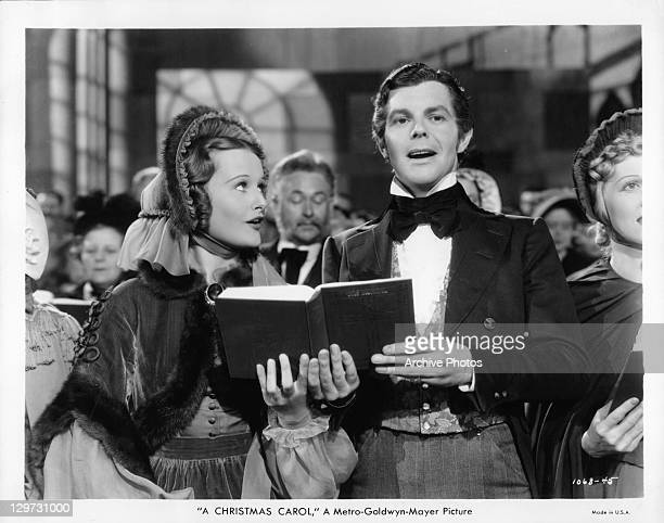 Lynne Carver and Barry MacKay singing in a scene from the film 'A Christmas Carol' 1938