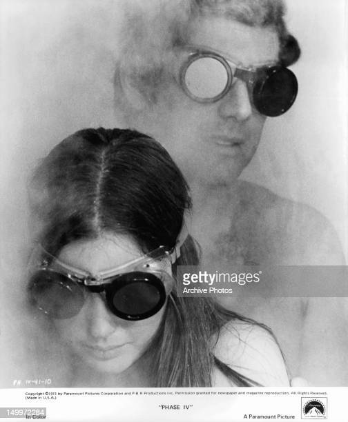 Lynne Frederick and Michael Murphy attempt to escape the hypnotic powers of superintelligent forces in a scene from the film 'Phase IV' 1974
