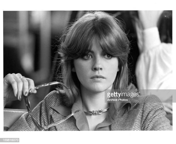 Lynne Frederick holding her glasses in a scene from the film 'Schizo' 1976