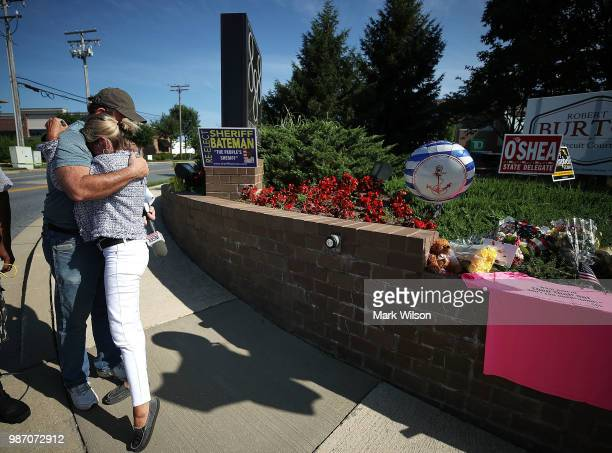 Lynne Griffin receives a hug from a stranger at makeshift memorial near the Capital Gazette where 5 people were shot and killed by a gunman on...
