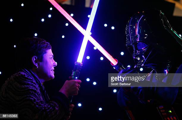 Lynne Kosky Victoria's Minister for Public Transport and Minister for the Arts has a lightsaber battle with an actor dressed as Darth Vader during a...